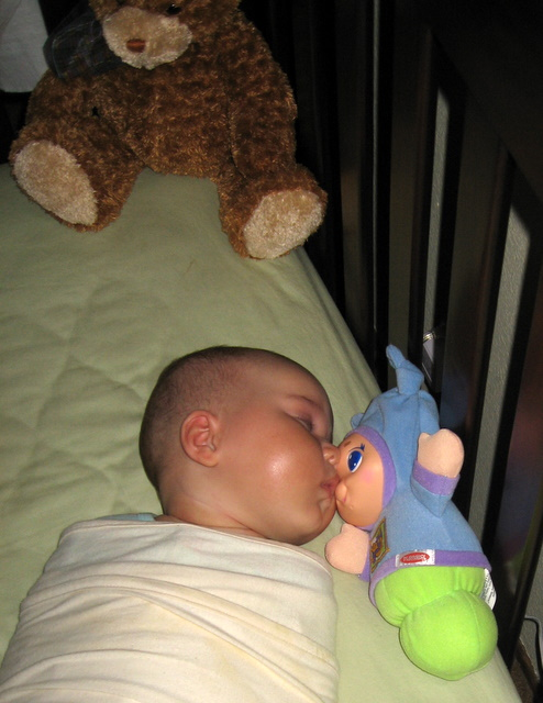 Ari kissing sleepytime buddy