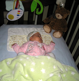 Ari sleeping in her crib
