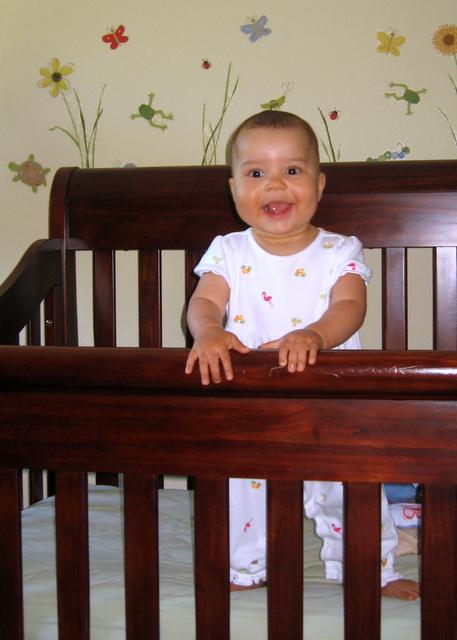 Happy standing baby